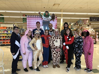 """In Honor Of Thomas Beginning His Training For Perishable Manager, Store 498 And Store 492 Celebrated """"Onesie Day!"""""""